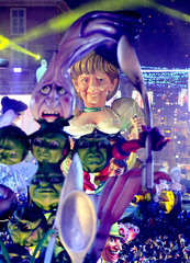 A float that portrays German Chancellor Angela Merkel makes it way through the crowd during the Carnival parade in Nice