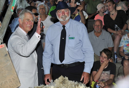 Britain's Prince Charles waves to well wishers alongside Rob Wright, President of Albany's Agricultural Society, during Prince Charles' visit to the Albany Agricultural Fair in Western Australia