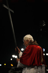 Pope Benedict XVI holds a cross as he leads a Via Crucis procession during Good Friday celebrations in Rome