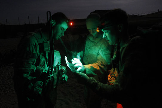 U.S. soldiers from Charlie troop, 4-73 Cavalry Regiment, 4th brigade, 82nd Airborne division look at maps before a joint mission with the Afghan Army in the Maiwand district