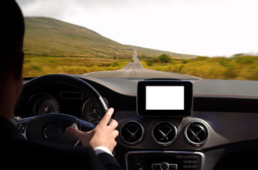 Man driving car trough the mountains, with isolated screen on dashboard