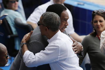 U.S. President Barack Obama  hugs former MLB right fielder Dave Winfield at an exhibition baseball game in Havana
