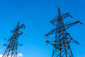 High-voltage lines against the blue sky.