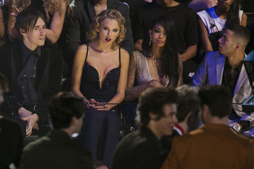 "Taylor Swift reacts as she listens to members of the band One Direction accept the award for song of the summer for ""Best Song Ever"" during the 2013 MTV Video Music Awards in New York"