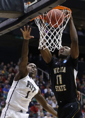 Wichita State forward Cleanthony Early gets a dunk past Pittsburgh guard Tray Woodall during the second half of their second round NCAA tournament basketball game in Salt Lake City, Utah