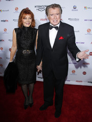 TV personality Regis Philbin and his wife Joy Philbin arrive for the International Emmy Awards in New York