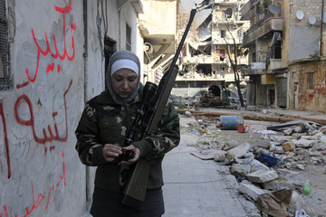 Guevara, a Syrian Palestinian woman married to an Al Wa'ad battalion commander, is pictured in Aleppo