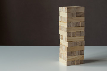 Tower from wooden blocks. Jenga board game