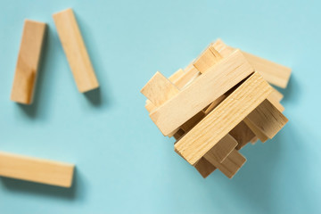 Jenga board game. Tower from wooden blocks.