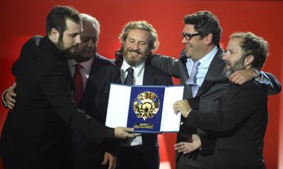 Director Carlos Vermut and his production team hold the Concha de Oro at the San Sebastian Film Festival