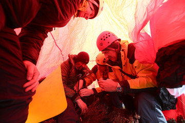 Volunteers from the Cairngorm Mountain Rescue Team practice rescuing an injured walker during a training day in the Cairngorm mountains near Aviemore, Scotland