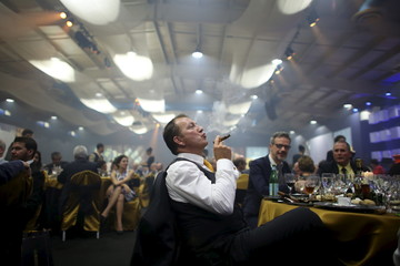 Juan Philippe from France enjoys a cigar during the gala dinner of the closing of the XVIII Habanos Festival in Havana