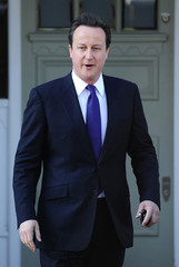 Britain's Prime Minister David Cameron leaves his home in London