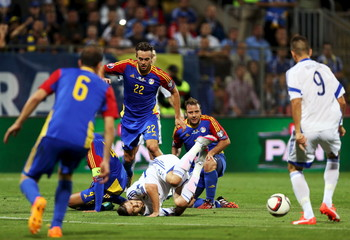 Bosnia Zec is challenged by Rodriguez of Andorra during their Euro 2016 qualifying soccer match in Zenica