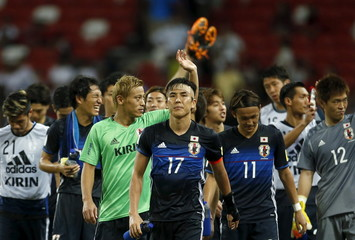 Japan's Keisuke Honda waves to fans after their 2018 World Cup Group E qualifying soccer match against Singapore at the National Stadium in Singapore