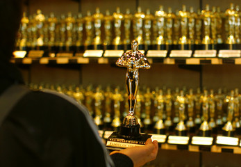 A shopper holds a replica of the Oscar statuette in a shop ahead of the 82nd Academy Awards in Hollywood