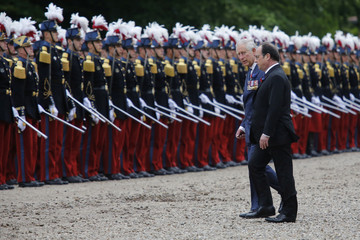 French president Francois Hollande and Britain's Prince Charles attend a ceremony at the Franco-British National Memorial in Thiepval near Albert