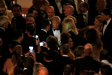 Trump works the crowd at a pre-inauguration candlelight dinner with donors at Union Station in Washington