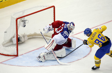 Sweden's Klasen scores against goaltender Salak of the Czech Republic during a penalty shoot out during their men's ice hockey World Championship Group A game at Chizhovka Arena in Minsk