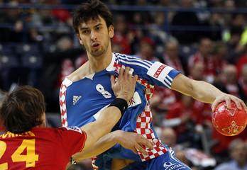 Croatia's Kopljar is guarded by Spain's Morros during their Men's European Handball Championship third place match in Belgrade
