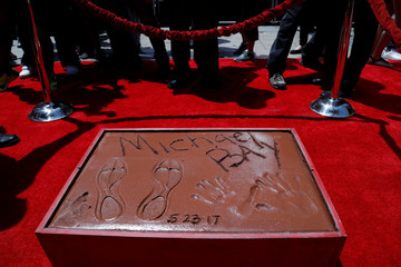 The handprints, footprints and signature of director Michael Bay in cement at a ceremony in the forecourt of the TCL Chinese theatre in Los Angeles