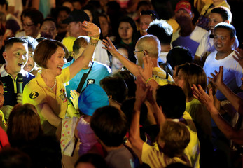 """Geraldine Roman, a transgender congressional candidate, waves to her supporters during a """"Miting de Avance"""" (last political campaign rally) for the national election in Orani town"""