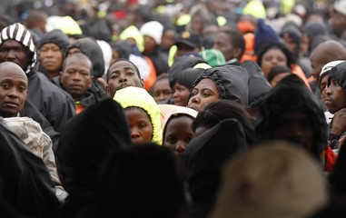 Workers who were deployed as stewards wait to receive payment in Durban
