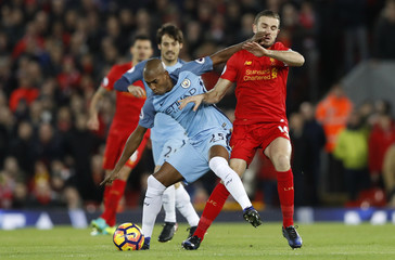 Liverpool's Jordan Henderson in action with Manchester City's Fernandinho