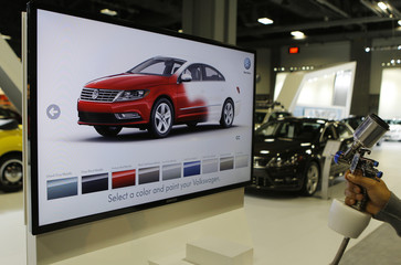 A unique Volkswagen consumer interactive display that allows potential buyers to spray paint different models in different colors is seen at the Washington Auto Show