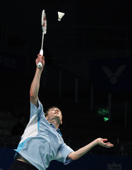 Denmark's Peter Hoeg Gade returns a shot to Malaysia's Lee Chong Wei in their men's singles match in the preliminary round at the 2010 Badminton World Federation Super Series finals in New Taipei City