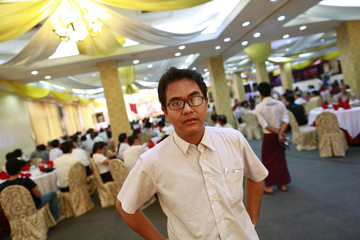 Former political prisoner and blogger Nay Phone Latt poses for a photo at a ceremony in Yangon