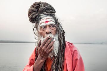 Portrait of sadhu smoking in the boat, Varanasi, India.