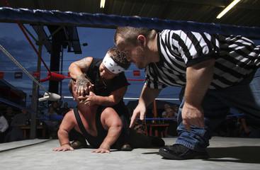 Wrestlers perform at the biker bar Suck Bang Blow in Murrells Inlet