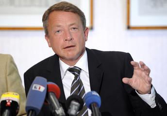 Brunkhorst, President of German Organisation for Nephrology, gestures during a news conference in Hamburg.