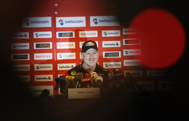 Cuche of Switzerland smiles as he gives a news conference in Kitzbuehel