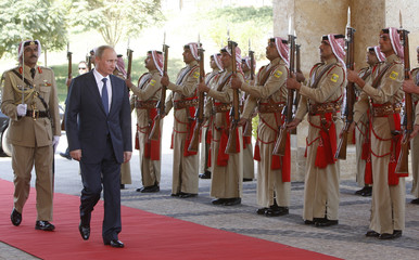 Russia's President Putin reviews a Bedouin guard of honour upon his arrival at King Hussein Bin Talal Convention Centre on the Jordanian side of the Dead Sea