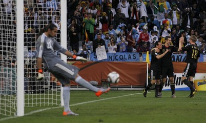 Argentina's goalkeeper Romero kicks ball after conceding a fourth goal by Germany during the 2010 World Cup quarter-final soccer match at Green Point stadium