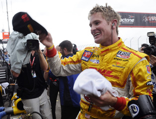 Andretti Autosport's Ryan Hunter-Reay of the U.S. smiles after winning the pole position during the Indy Car Series qualifying session in Edmonton