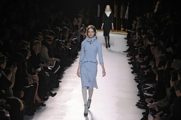 A model presents a creation by English designer Peter Copping for Nina Ricci fashion house as part of their Fall-Winter 2011/2012 women's ready-to-wear fashion collection during Paris Fashion Week