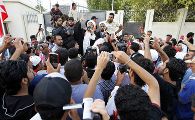 Sheikh Mohammed Habib Muqdad shouts anti-government slogans while talking to protesters in front of the Bahrain Immigration Directorate in Manama