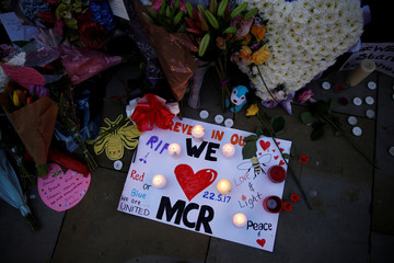 Flowers and messages are left for the victims of the Manchester Arena attack in central Manchester