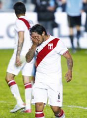 Peru's Vargas walks off the field after receiving a red card for a foul against Uruguay's Coates in their semi-final soccer match at the Copa America in La Plata