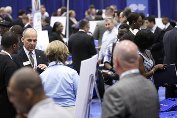 Jobseekers talk with recruiters at a Hire Our Heroes job fair targeting unemployed military veterans and sponsored by the Cable Show, a cable television industry trade show in Washington