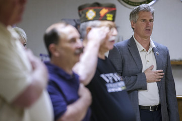 Scott Brown, a Republican candidate for the U.S. Senate, recites the U.S. Pledge of Allegiance along with the audience at a town hall campaign stop at a VFW post in Hudson