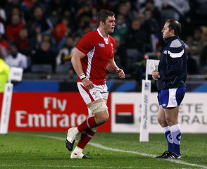 Wales' Danny Lydiate bleeds from his head as he leaves the field during their Rugby World Cup semi-final match against France at Eden Park in Auckland