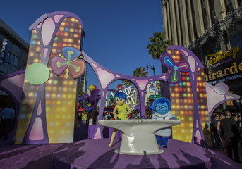 """Joy"" and ""Sadness"", the characters of the animation film ""Inside Out"", pose at its premiere at El Capitan theatre in Hollywood"