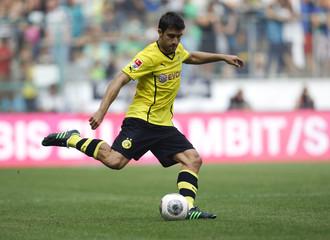 Borussia Dortmund's Sokratis kicks a ball during the Telekom Cup soccer match against Borussia Moenchengladbach in Moenchengladbach