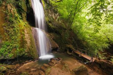 Beautiful Ripaljka Waterfall, bridge and cave, travel destination, Ozren mountain, Sokobanja, Serbia