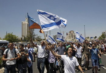 Israeli youths take part in a protest in Jerusalem calling to approve a bill in parliament