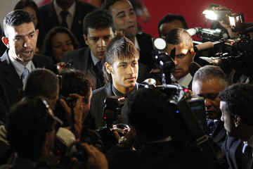 Santos soccer player Neymar is surrounded by members of the media as he arrives for a ceremony celebrating the club's 100th anniversay in Brasilia